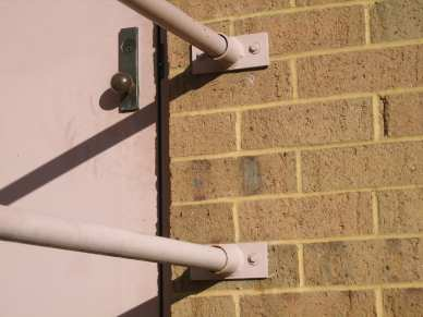 "3/4"" lag shield short - brick - safety railing"