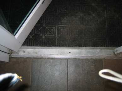 "1/4"" x 1-1/4"" flat 410 Stainless Steel tapcon - concrete - door threshold"